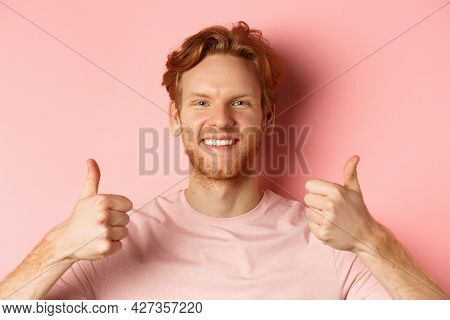 Close Up Of Cheerful Man With Red Hair And Beard, Showing Thumbs Up And Smiling, Saying Yes, Approve