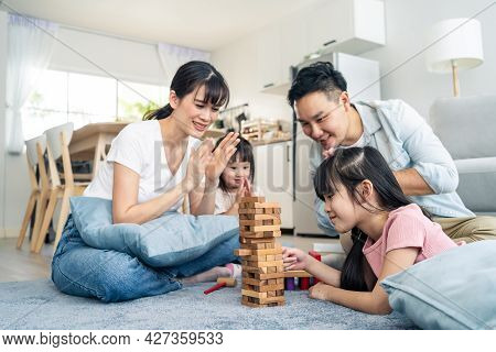 Asian Family Spending Time Together On Holiday In Living Room At Home. Attractive Happy Parents, Fat