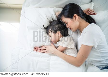 Asian Happy Family Stay Home, Mother Sleep With Daughter In Bedroom. Attractive Loving Parent, Mom S
