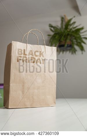 Cardboard Bag Written Black Friday On The Table Brown Paper Packaging With Custom Writing And Living