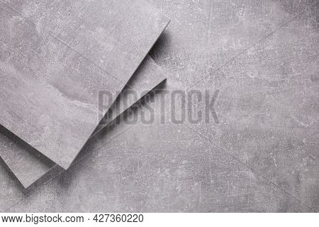 Abstract grey background texture at table or wall. Gray panel of chipboard at table background surface