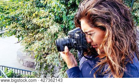 Beautiful Woman Is A Professional Photographer With A Dslr Camera In The Park.