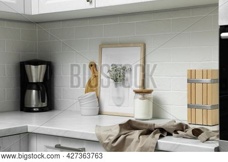 Silicone Vase With Flowers On Countertop In Kitchen