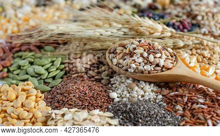Closed Up Dry Organic Cereal And Grain Seeds In Wooden Spoon On Variety Kinds Of Natural Grain Seeds