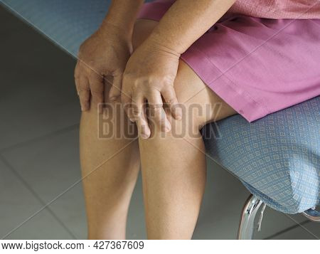 Woman Holding Her Knees, Knee Pain Rare Disorder Body Immune System Attacks Nerves, Guillan Barre Sy