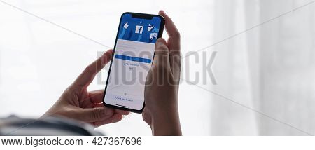 Chiang Mai ,thailand Jul 18 2021 : Woman Holding A Iphone X With Social Internet Service Facebook On