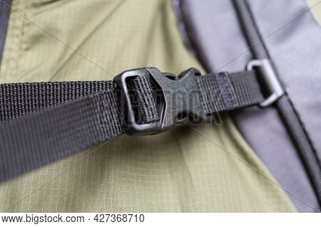 Backpack Chest Buckle. Touring Backpack Strap With Buckle. Black Fastex. Front View.
