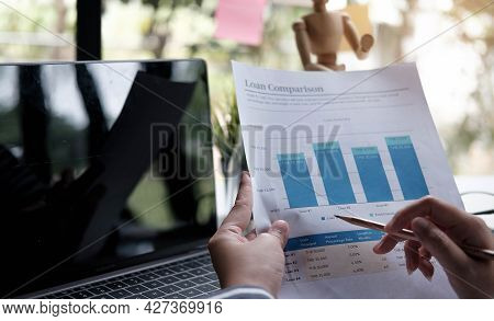 Close Up Of Business Woman Investment Consultant Analysis Company Annual Financial Report Balance Sh