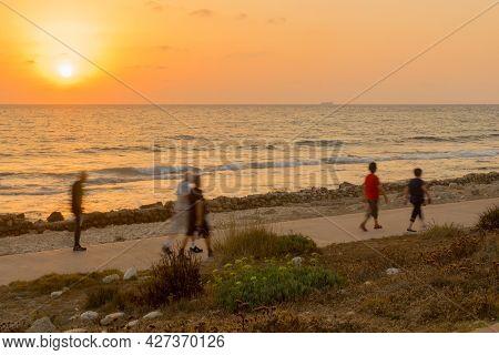 Sunset Scene Of People Movement On Hecht Promenade, The Carmel Coast, Haifa, Northern Israel