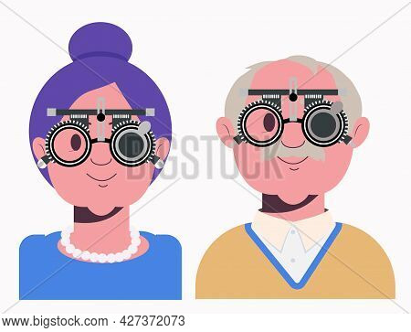 Elders Vision Checkup In Ophthalmological Clinic. Optometrist Checking Grandmother And Grandfather E