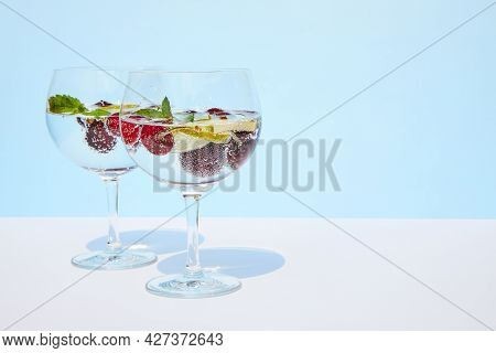 Cool Sparkling Water, Lemonade, Water, Cocktail With Fresh Cherries And Mint Leaves Stands On A Past