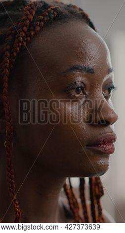 Close-up Of African Woman Meditating In Lotus Position Sitting On Yoga Mat With Closed Eyes At Home