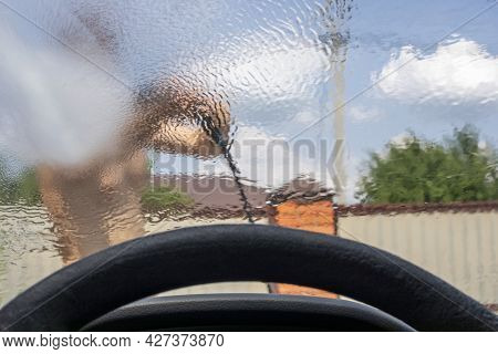 Look Through The Blurred Windshield Of A Car At A Heavy Downpour, Flood