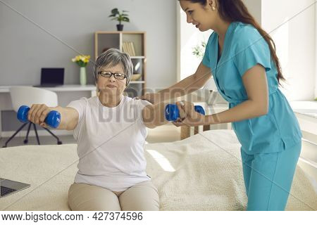Nurse Physiotherapist Doctor Working With Elderly For Physical Recovery