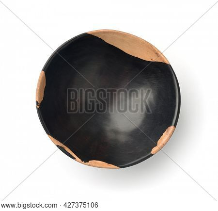 Top view of empty ebony wood bowl isolated on white