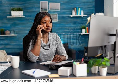 Black Student Sitting At Desk Table In Living Room Working At High School Homework Discussing With C