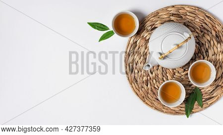 Tray With Teapot And Tea Cups With Tea Drink Top View On White Background. Asian Tea Ceremony.