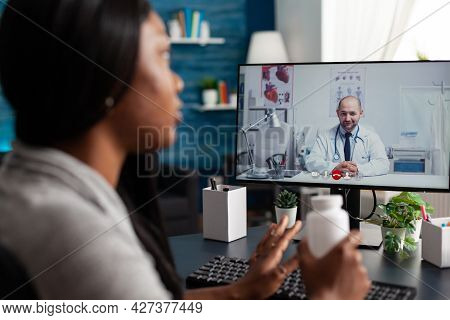 Afro American Patient Discussing Pills Treatment Against Respiratory Sickness With Therapist During