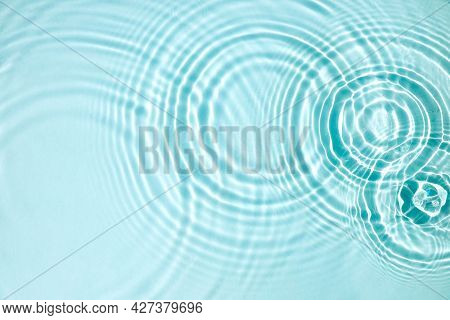 Blue Water Texture, Blue Mint Water Surface With Rings And Ripples. Spa Concept Background. Flat Lay