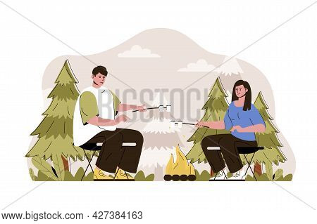 Campfire Concept. Couple Fries Marshmallows At Campsite In Forest Situation. Outdoor Activity, Touri