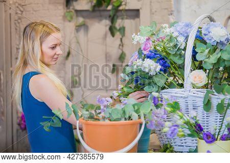 Professional Woman Floral Artist, Florist Making Large Floral Basket With Flowers At Workshop, Flowe