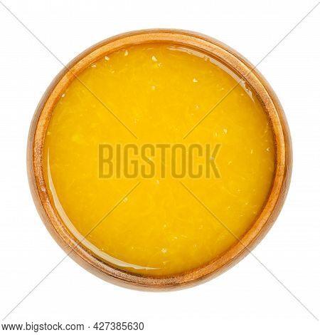 Freshly Pressed Orange Juice With Fruit Pulp In A Wooden Bowl. Freshly Squeezed Orange-juice, A Swee
