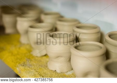 Unfinished Mugs In Row On Shelf Of Pottery Workshop, Ceramic Studio - Close Up View. Crafting, Diy,