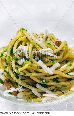 spaghetti with bacon, parsley and parmesan cheese
