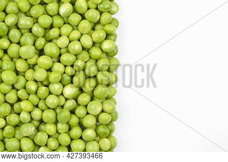 Fresh Green Peas On A White Background.the Concept Of Growing And Caring For Agriculture, Biology, A