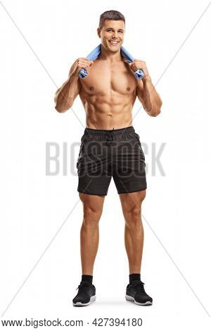 Full length portrait of a young fit topless man with a towel around his neck isolated on white background