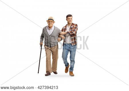 Young man helping an old man with a walking cane isolated on white background