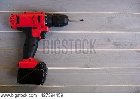 Red Drill. Close-up. Repair Tool. Screwdriver Or Electric Screwdriver.