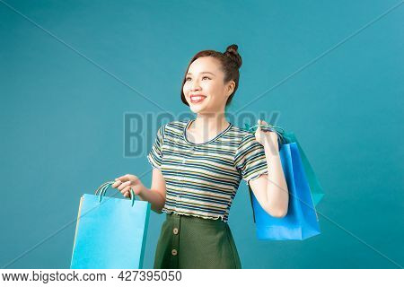 Woman Take Shopping Bag Happily On Blue Background