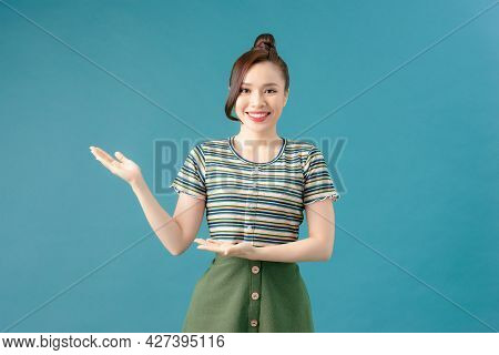 Woman Showing Your Product Isolated On Blue