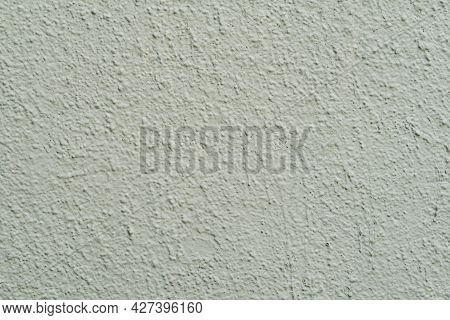 Texture Of Painted Light Green Colour Concrete Wall. Stucco Wall Close-up, Background