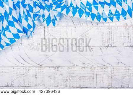 Traditional Oktoberfest Table Cloth On Empty White Wooden Background. Copy Space
