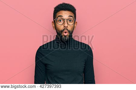 Young african american man wearing casual clothes scared and amazed with open mouth for surprise, disbelief face