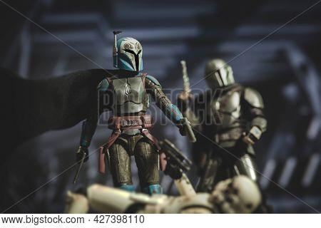 JULY 20 2021: Disney Plus Star Wars The Mandalorian Bo Katan Kryze and Din Djarin battle Imperial stormtroopers - Hasbro action figure