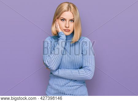 Young blonde woman wearing casual clothes thinking looking tired and bored with depression problems with crossed arms.