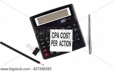 Cpa Cost Per Action Text On Sticker On Calculator With Pen,pencil On White Background