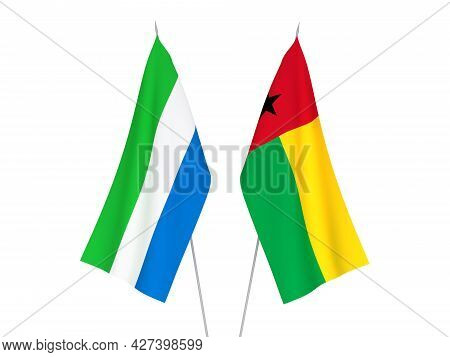 National Fabric Flags Of Sierra Leone And Republic Of Guinea Bissau Isolated On White Background. 3d