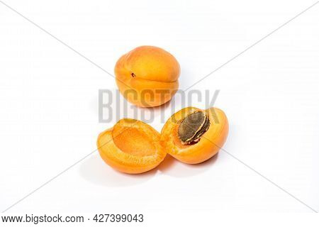 Fresh Apricot Fruits. Apricot Isolated On White Background. Sweet Open Apricots With Kernel Closeup.