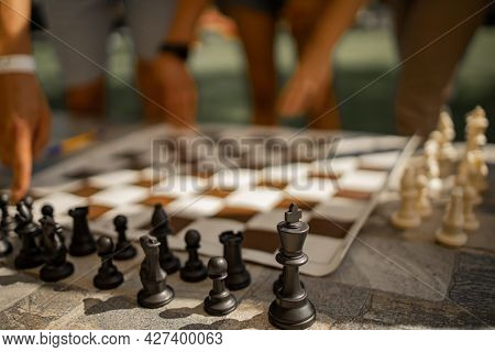 Hand Of Businessman Moving Chess Figure In Competition Board Game For Develop
