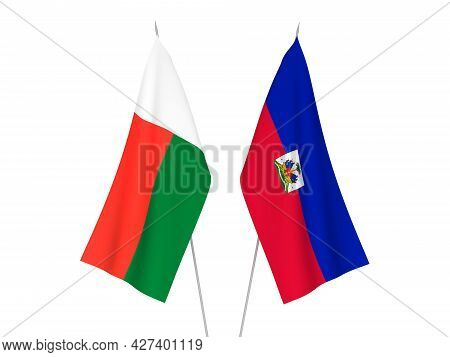 National Fabric Flags Of Madagascar And Republic Of Haiti Isolated On White Background. 3d Rendering