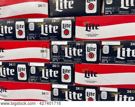 Cases Of Cans Of Miller Lite Beer At A Grocery Store Waiting For Customers To Purchase.
