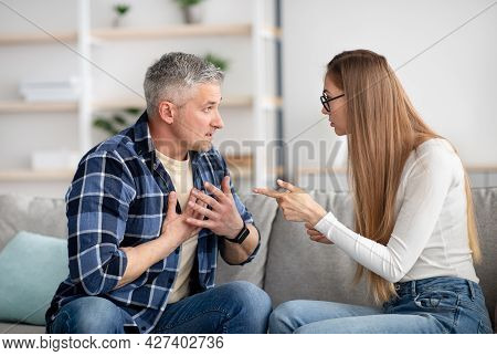 Irritated Mature Woman Quarreling With Her Husband At Home, Being Angry, Experiencing Family Problem