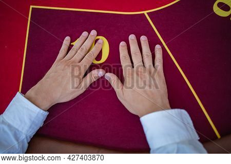 Poker Game, Table View With Hands On Casino Table
