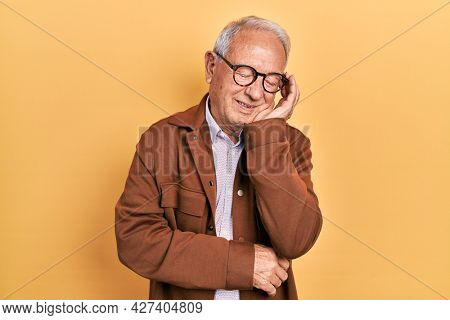 Senior man with grey hair wearing casual jacket and glasses thinking looking tired and bored with depression problems with crossed arms.