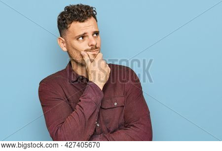 Young hispanic man wearing casual clothes thinking worried about a question, concerned and nervous with hand on chin