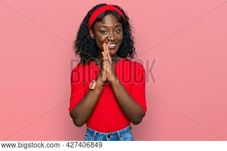 Beautiful african young woman wearing casual clothes praying with hands together asking for forgiveness smiling confident.